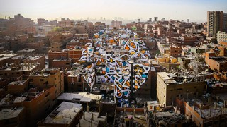 A project of peace, painted across 50 buildings