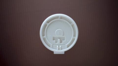 The evolution of the coffee cup lid   A.J. Jacobs